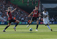 Fulham's Andre-Frank Zambo Anguissa (right) under pressure from Bournemouth's David Brooks (left) and Dominic Solanke (centre)<br /> <br /> Photographer David Horton/CameraSport<br /> <br /> The Premier League - Bournemouth v Fulham - Saturday 20th April 2019 - Vitality Stadium - Bournemouth<br /> <br /> World Copyright © 2019 CameraSport. All rights reserved. 43 Linden Ave. Countesthorpe. Leicester. England. LE8 5PG - Tel: +44 (0) 116 277 4147 - admin@camerasport.com - www.camerasport.com