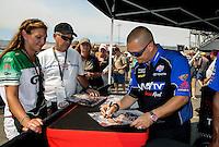 Jul. 26, 2013; Sonoma, CA, USA: NHRA top fuel dragster driver Brandon Bernstein signing autographs during qualifying for the Sonoma Nationals at Sonoma Raceway. Mandatory Credit: Mark J. Rebilas-
