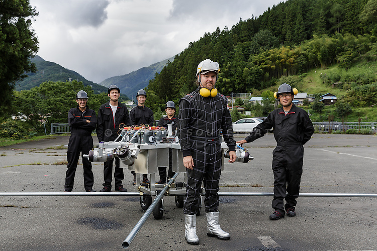 Minakami, Gunma prefecture, Japan, September 29 2016 - Beau Retallick is an Australian citizen based in Japan and the founder of Bungy Japan, a pioneer bungy jumping company in Japan. Beau Retallick is also an inventor and uses the money earned from bungy jumping to various projects. His latest invention is a jet powered drone with enough thrust to levitate a sumo wrestler.<br /> Beau Retallick and his team posing after testing the drone on the parking lot of the bungy jumping company.