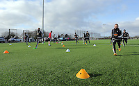 SWANSEA, WALES - JANUARY 28: Leon Britton (R) and other players warm up during the Swansea City Training Session on January 28, 2016 in Swansea, Wales.