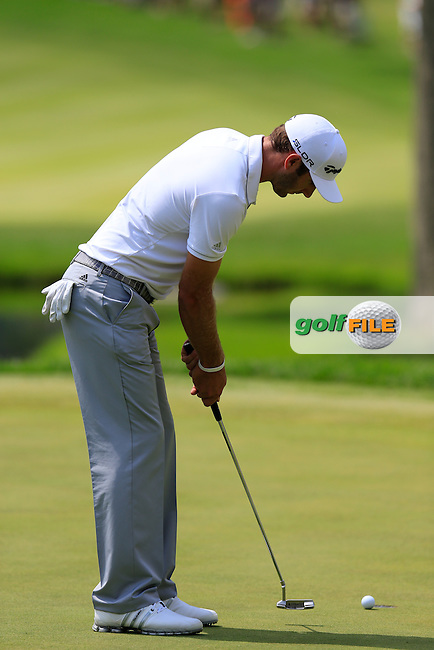 Dusin Johnson (USA) putts on the 3rd green during Saturday's Round 3 of the 2013 Bridgestone Invitational WGC tournament held at the Firestone Country Club, Akron, Ohio. 3rd August 2013.<br /> Picture: Eoin Clarke www.golffile.ie