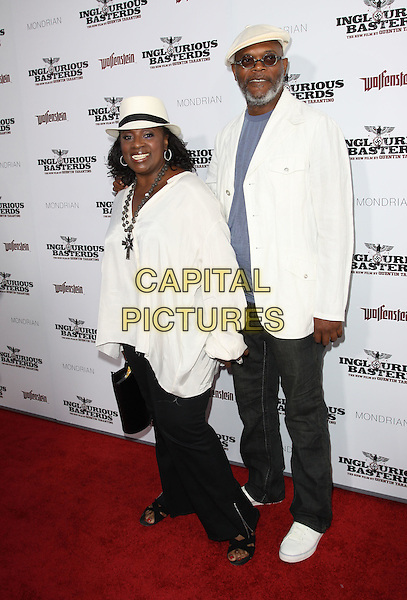 "LaTANYA RICHARDSON & SAMUEL L. JACKSON.The L.A. premiere of ""Inglourious Basterds"" held at The Grauman's Chinese Theatre in Hollywood, California, USA. .August 10th, 2009 .full length white flat cap hat fedora trilby suit jacket sunglasses shades top necklace married husband wife beard facial hair jeans denim trousers black .CAP/ADM/KB.©Kevan Brooks/AdMedia/Capital Pictures."