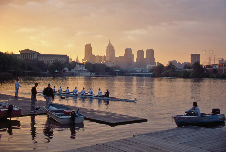 Philadelphia, Rowers, Schuylkill River, Boat House Row, crew in eight-oared racing shell at sunrise,  Pennsylvania, United States..