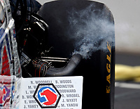 Apr 20, 2018; Baytown, TX, USA; Detailed view as exhaust smoke comes from the header pipes on the engine of NHRA top fuel driver Antron Brown during qualifying for the Springnationals at Royal Purple Raceway. Mandatory Credit: Mark J. Rebilas-USA TODAY Sports