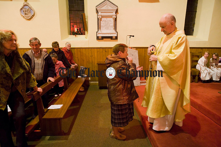Sacristian Ita Cusack accepting the sacrament of holy communion from Bishop of Limerick Donal Murray  at the celebratory mass for the 150 year anniversary of the Little Church Sixmilebridge in Cratloe Parish. Photograph by John Kelly.