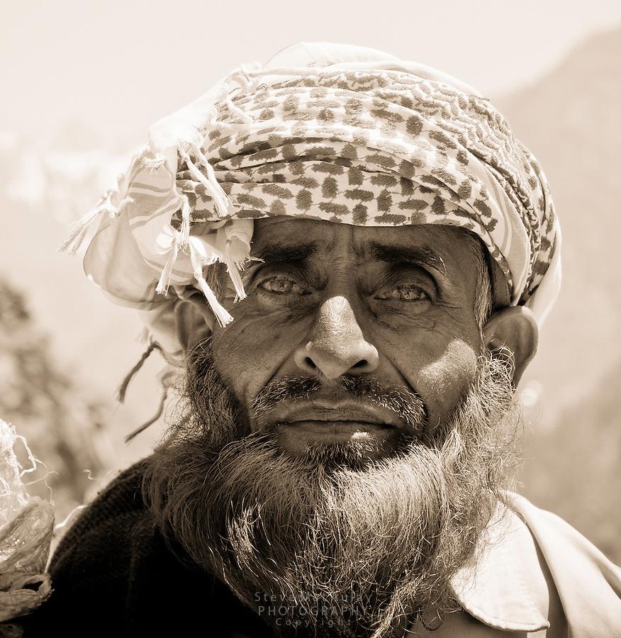 Bakarwal tribal sheep herder, with bright, henna red colored beard, Kashmir, India
