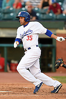 Chattanooga Lookouts outfielder Brian Cavazos-Galvez (35) hits a double during a game against the Birmingham Barons on April 24, 2014 at AT&T Field in Chattanooga, Tennessee.  Chattanooga defeated Birmingham 5-4.  (Mike Janes/Four Seam Images)