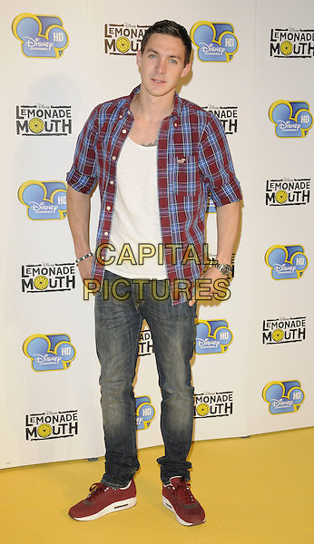 """KIRK NORCROSS .""""Lemonade Mouth"""" special TV screening, BAFTA, Piccadilly, London, England..August 25th, 2011.full length jeans denim white top blue red check shirt.CAP/CAN.©Can Nguyen/Capital Pictures."""