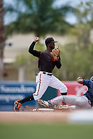 GCL Orioles second baseman Carlos Baez (13) throws to first base throws to first base during a Gulf Coast League game against the GCL Braves on August 5, 2019 at Ed Smith Stadium in Sarasota, Florida.  GCL Orioles defeated the GCL Braves 4-3 in the second game of a doubleheader.  (Mike Janes/Four Seam Images)