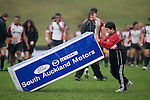 One of the ball boys pushes  a goal post pad to the other end of the field after the Air New Zealand Cup pre-season rugby game between the Counties Manukau Steelers & Northland, played at Growers Stadium on July 21st, 2007. Counties Manukau won 28 - 17.
