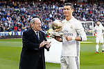 Real Madrid's Cristiano Ronaldo golden ball 2016 with the Real Madrid's Honor President Paco Gento during La Liga match. January 7,2016. (ALTERPHOTOS/Acero)