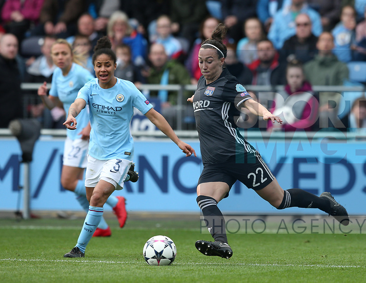 Lucia Bronze of Lyon clears the ball under pressure from Jennifer Beattie of Manchester City during the Women's Champions League, Semi Final 1st leg match at the Academy Stadium, Manchester. Picture date 22nd April 2018. Picture credit should read: Simon Bellis/Sportimage
