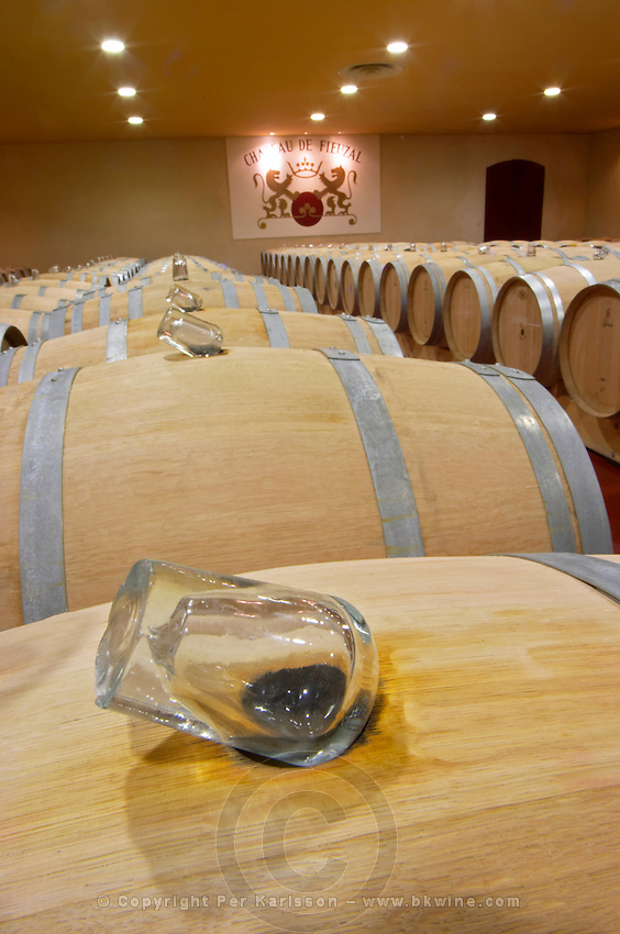 glass bung stoppers on barrels fermenting must white wine chateau fieuzal pessac leognan graves bordeaux france
