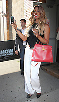 NEW YORK, NY - JUNE 29:  Laverne Cox records a Snapchat video of fans and photographers as she leaves 'The Daily Show with Trevor Noah' where she talked about season 4 of Netflix's 'Orange is the New Black' in New York, New York on June 29, 2016.  Photo Credit: Rainmaker Photo/MediaPunch