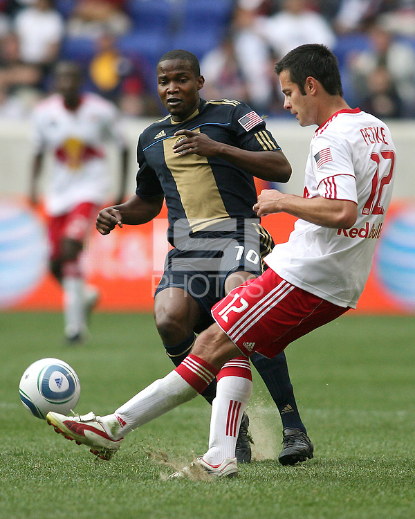 Danny Mwanga #10 of the Philadelphia Union watches Mike Petke #12 clear the ball during a MLS match against the New York RedBulls on April 24 2010, at RedBulll Arena, in Harrison, New Jersey.RedBulls won 2-1.