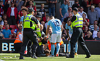Sergio Aguero of Manchester City appears unhappy with how stewards and police handle a Man City supporter during the Premier League match between Bournemouth and Manchester City at the Goldsands Stadium, Bournemouth, England on 26 August 2017. Photo by Andy Rowland.