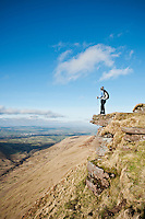 Female hiker enjoys view from Fan Y Big, Brecon Beacons national park, Wales