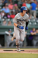 First baseman Danny Edgeworth (16) of the Asheville Tourists runs out a batted ball in a game against the Greenville Drive on Friday, August 23, 2019, at Fluor Field at the West End in Greenville, South Carolina. Greenville won, 11-1. (Tom Priddy/Four Seam Images)
