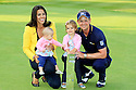 Luke Donald (ENG) poses with his family after the final round of the BMW PGA Championship played on the West Course, Wentworth Club, Virginia Water, Surrey, England 24 - 27 May 2012. (Picture Credit / Phil Inglis)