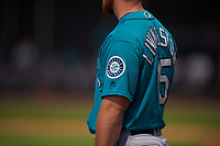 A detailed view of the Seattle Mariners logo on the sleeve of AZL Mariners manager Zac Livingston (15) as he coaches third base during an Arizona League game against the AZL D-backs on July 3, 2019 at Salt River Fields at Talking Stick in Scottsdale, Arizona. The AZL D-backs defeated the AZL Mariners 3-1. (Zachary Lucy/Four Seam Images)