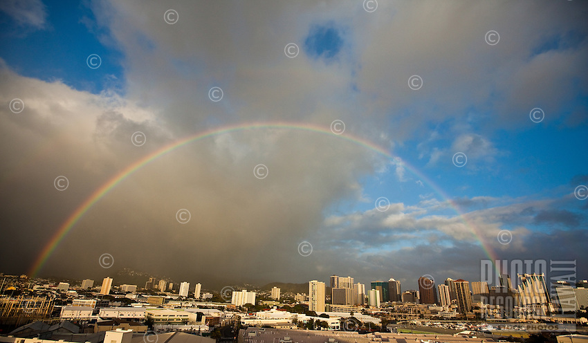 View of Dole Cannery and downtown Honolulu from above, with a rainbow in the background