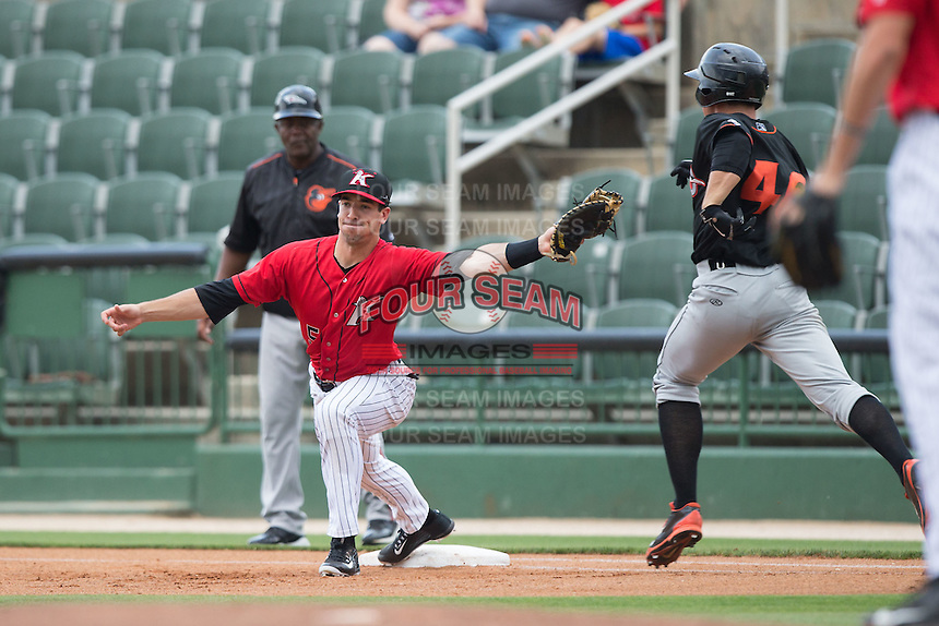 Kannapolis Intimidators first baseman John Ziznewski (5) stretches for a throw as Derek Peterson (46) of the Delmarva Shorebirds hustles down the line at CMC-Northeast Stadium on June 7, 2015 in Kannapolis, North Carolina.  The Shorebirds defeated the Intimidators 9-1.  (Brian Westerholt/Four Seam Images)