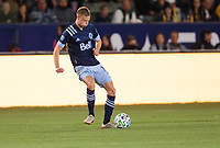 CARSON, CA - MARCH 07: Andy Rose #15 of the Vancouver Whitecaps passes off the ball during a game between Vancouver Whitecaps and Los Angeles Galaxy at Dignity Health Sports Park on March 07, 2020 in Carson, California.
