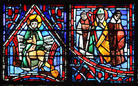 St Gilles with his deer in front of a musical score (left), representing the many liturgical songs which Fulbert wrote, and Fulbert with 2 monks (right), possibly from the Holy Father Abbey where he was buried, from the Life of Fulbert stained glass window, in the south transept of Chartres Cathedral, Eure-et-Loir, France. This window replaces the original 13th century window depicting the Life of St Blaise, which was destroyed in 1791. It was created in 1954 by Francois Lorin as a gift of the Institute of American Architects, on a theme chosen by the Canon Yves Delaporte. It depicts the life of Fulbert, bishop of Chartres in the 11th century. Chartres cathedral was built 1194-1250 and is a fine example of Gothic architecture. Most of its windows date from 1205-40 although a few earlier 12th century examples are also intact. It was declared a UNESCO World Heritage Site in 1979. Picture by Manuel Cohen
