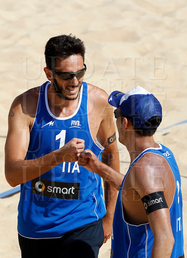 Italy's Paolo Nicolai, left, and Daniele Lupo celebrate uring the match between Italy and Austria at Beach Volleyball World Tour Grand Slam, Foro Italico, Rome, 21 June 2013.<br /> UPDATE IMAGES PRESS/Isabella Bonotto