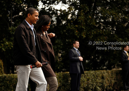 Washington, DC - March 7, 2009 -- United States President Barack Obama and wife, Michelle Obama, depart the South Lawn of the White House en route Camp David for the weekend, Saturday, March 7, 2009..Credit: Martin H. Simon / Pool via CNP