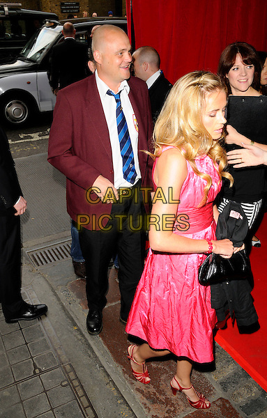 AL MURRAY & GUEST.At the Mojo Honours List Awards held at Old Truman Brewery, London, England, June 16th 2008. .arrivals full length red jacket blue striped tie pink dress .CAP/CAN.©Can Nguyen/Capital Pictures