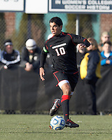 Northeastern University midfielder Andre Ciliotta (10) looks to pass..NCAA Tournament. University of Connecticut (white) defeated Northeastern University (black), 1-0, at Morrone Stadium at University of Connecticut on November 18, 2012.