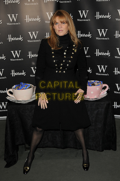 """SARAH FERGUSON, DUCHESS OF YORK.at Waterstones booksigning of her new childrens book """"Tea for Ruby""""..Harrods, Knightsbridge, London.6th December 2008..full length black dress.CAP/CAN.©Can Nguyen/Capital Pictures."""