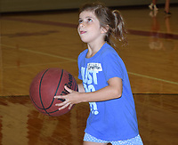 RICK PECK/SPECIAL TO MCDONALD COUNTY PRESS<br /> Leighton Freeman, 8, Pineville, eyes the basket for a shot during a youth basketball/volleyball camp held July 8-10 at McDonald County High School.