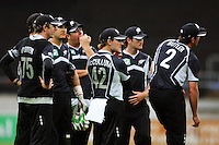 The Black Caps wait for the game to resume during the 2nd ODI cricket match between the New Zealand Black Caps and India at Westpac Stadium, Wellington, New Zealand on Friday, 6 March 2009. Photo: Dave Lintott / lintottphoto.co.nz