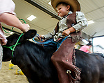 Dawson Dory dress as a cowboy rode his calf during the Bucket Calf event during the Warren County Fair.