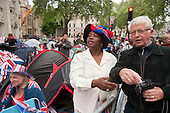 Spectators prepare to spend the night along the route from Buckingham Palace to Westminster Abbey on the eve of the Royal Wedding.
