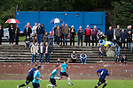 Harestanes AFC v Girvan FC, 15/08/2015. Scottish Cup preliminary round, Duncansfield Park. Spectators watching the second-half action as Harestanes AFC (in light blue) take on Girvan FC in a Scottish Cup preliminary round tie, staged at Duncansfield Park, home of Kilsyth Rangers. The home team were the first winners of the Scottish Amateur Cup to be admitted directly into the Scottish Cup in the modern era, whilst the visitors participated as a result of being members of both the Scottish Football Association and the Scottish Junior Football Association. Girvan won the match by 3-0, watched by a crowd of 300, which was moved from Harestanes ground as it did not comply with Scottish Cup standards. Photo by Colin McPherson.