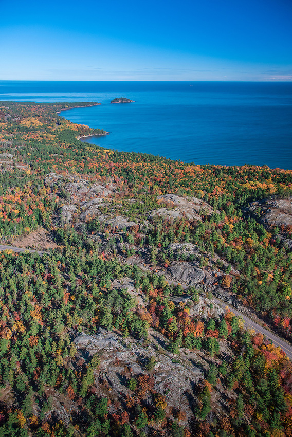 Aerial photography of  the rugged Lake Superior shoreline north of Marquette, Michigan during fall color season. Areas shown include County Road 550 rock cut, Sugarloaf Mountain lookout, Wetmore Landing Beach and Little Presque Isle.