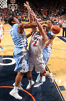 Virginia guard Joe Harris (12) is fouled by North Carolina forward James Michael McAdoo (43) during an NCAA basketball game against Virginia Monday Jan. 20, 2014 in Charlottesville, VA. Virginia defeated North Carolina 76-61.