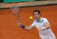 Britain's Andy Murray   during their Davis Cup quarter-final doubles tennis match against Italy's Fabio Fognini  Simone Bolelli in Naples April 5, 2014.