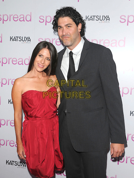 "SOLEIL MOON FRYE & JASON GOLDBERG .at The Anchor Bay Films screening of ""Spread""  held at The Arclight Theatre in Hollywood, California, USA,.August 3rd 2009.                                                                  .half length red strapless black suit tie dress.CAP/DVS.©Debbie VanStory/Capital Pictures"