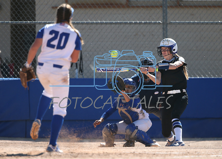Western Nevada's Dakota Robinson hits against College of Southern Nevada's Jaycie Lebaron at Edmonds Sports Complex in Carson City, Nev., on Friday, April 1, 2016. <br />Photo by Cathleen Allison/Nevada Photo Source