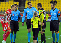 The captains prepare to take the coin toss before the A-League football match between Wellington Phoenix and Melbourne City FC at Westpac Stadium in Wellington, New Zealand on Sunday, 21 April 2019. Photo: Dave Lintott / lintottphoto.co.nz