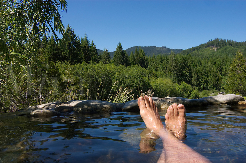 Relaxing in a hot pool at the Breitenbush Hot Springs in the Cascade Mountain range - Central Oregon