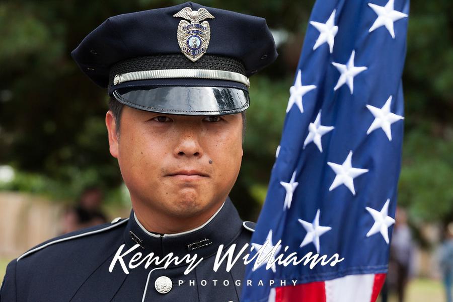 Portrait of Kent Police Man with American Flag, Kent Cornucopia Days, Kent, Washington State, WA, USA.