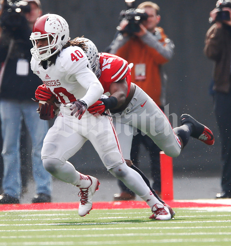 Indiana Hoosiers safety Indiana Hoosiers safety Antonio Allen (40) breaks a tackle on Ohio State Buckeyes running back Ezekiel Elliott (15)after making a interception in the 1st quarter at Ohio Stadium Nov. 22, 2014.(Dispatch photo by Eric Albrecht)