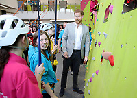 11 April 2019 - Prince Harry, Duke of Sussex starts a wall climbing competition during the official opening of the Barking & Dagenham Future Youth Zone in Dagenham, England.  The facility is created by the Charity OnSide Youth Zones and is the first of three facilities expected to open in 2019, which will provide a safe environment where young people can come and enjoy themselves, build key skills and raise their aspirations and confidence to create a happier and healthier generation. Photo Credit: ALPR/AdMedia