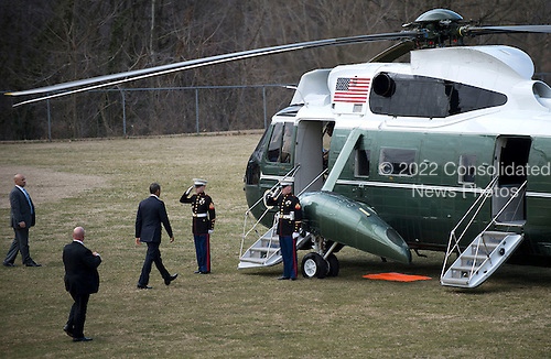 United States President Barack Obama walks to Marine One as he departs Walter Reed National Military Medical Center after visiting wounded military personnel, on March 5, 2013 in Bethesda, Maryland. .Credit: Kevin Dietsch / Pool via CNP