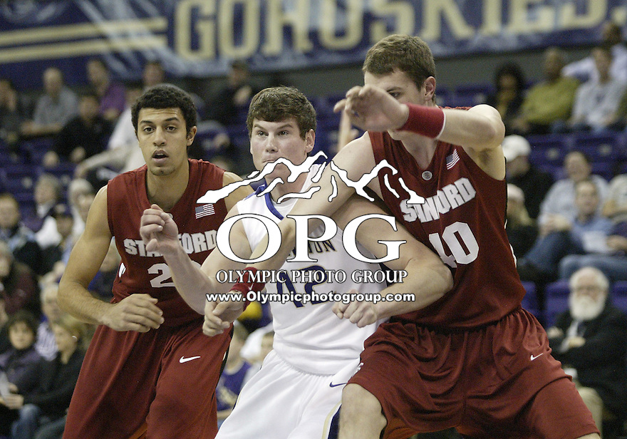 14 January 2010:  Washington Huskies #42 Brendan Sherrer and Stanford's #40 Elliott Bullock battle for position under the basket. Washington won 94-61over Stanford at the Bank of America Arena in Seattle, WA.